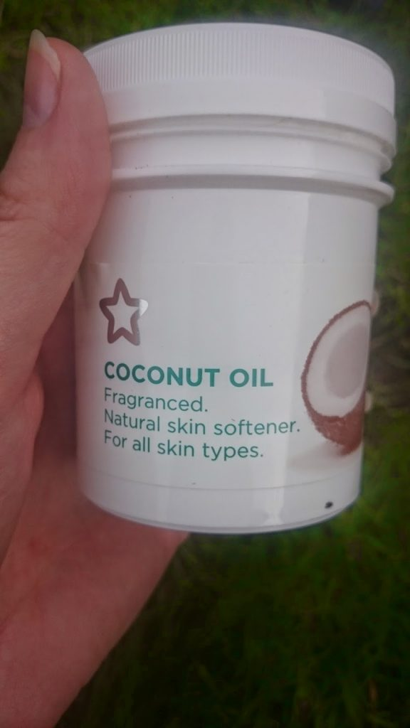 hand-holding-pot-of-superdrug-coconut-oil