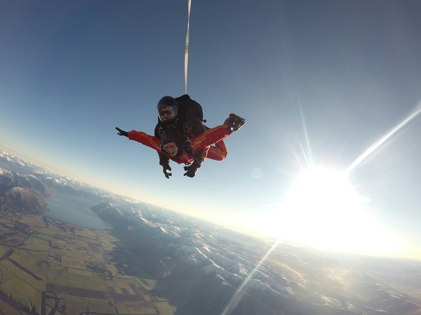 young-woman-and-skydiver-mid-air-skydiving-in-new-zealand