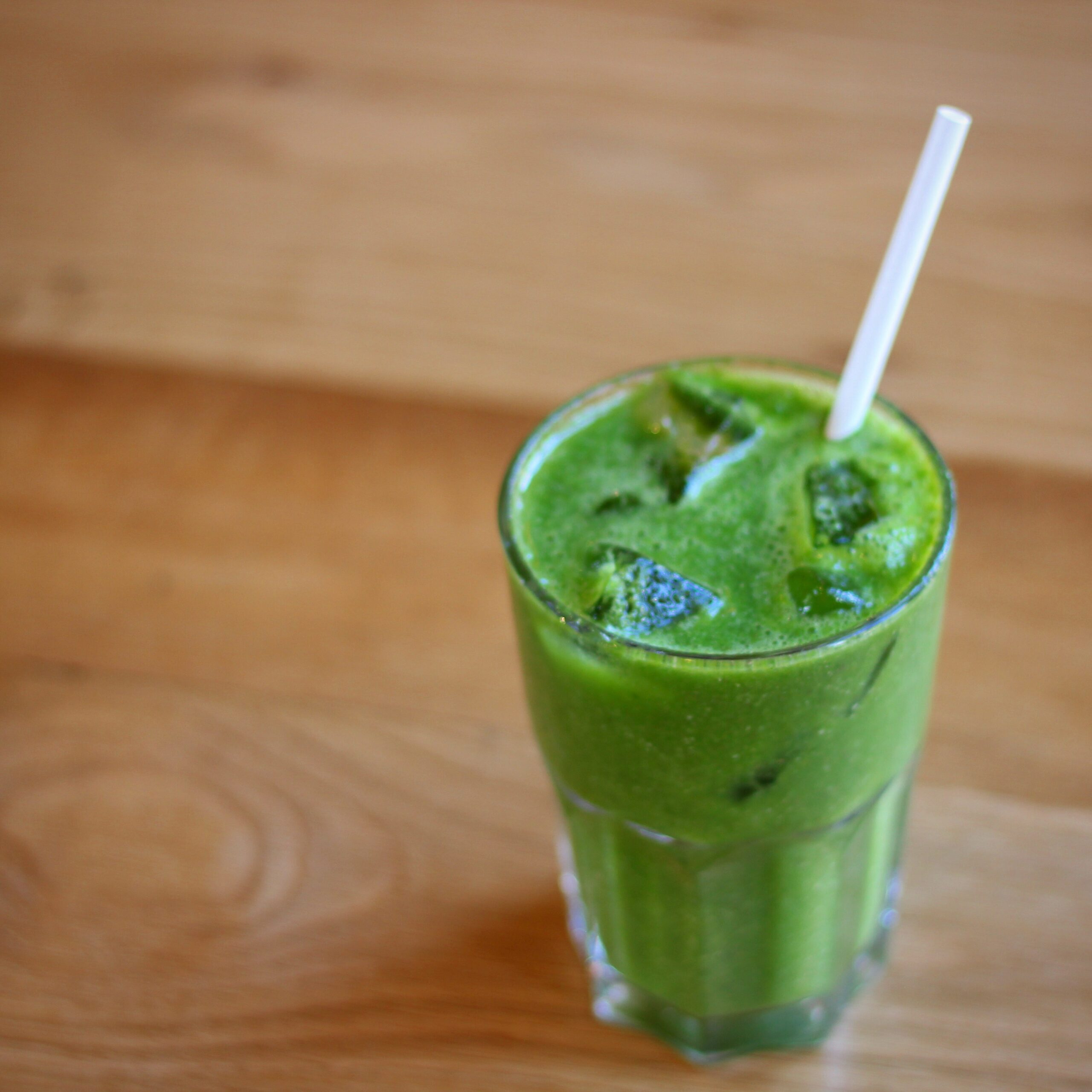 glass-of-green-smoothie-with-ice-and-straw-from-Boston Tea Party