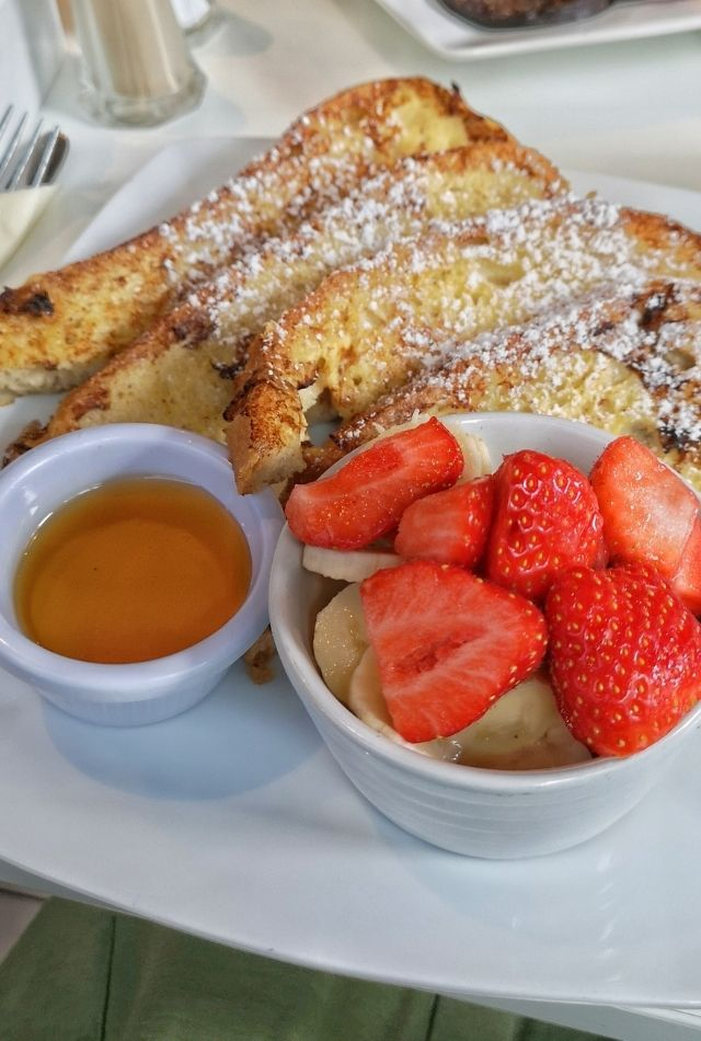 Strawberries, french toast and syrup on plate at Lemon Jelly Cafe, Dublin