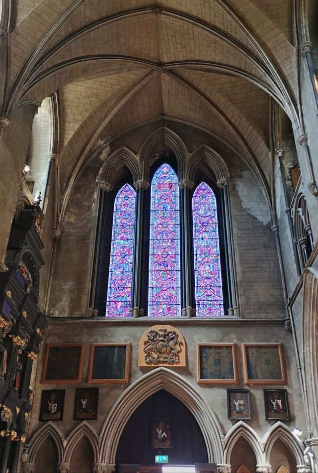 Purple stainglass window in St Patrick's Cathedral in Dublin, Ireland
