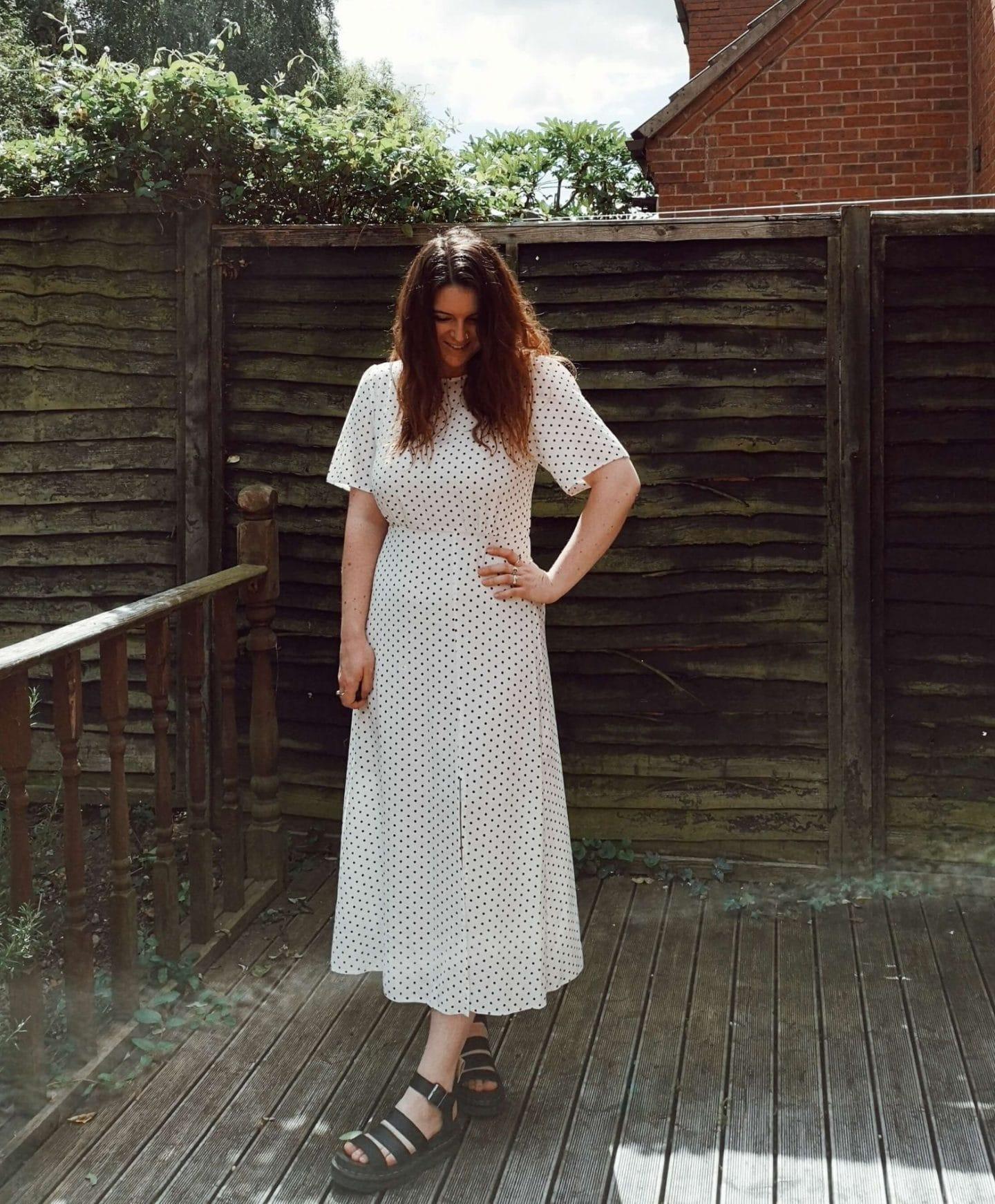 Woman standing in polkadot dress in garden